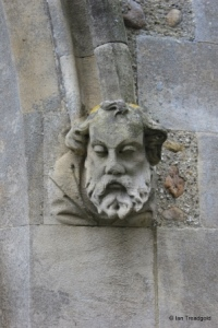 Great Barford - All Saints. South door corbel.