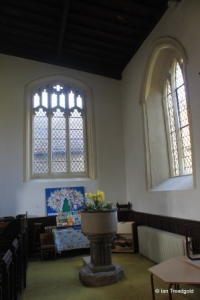 Harrold - St Peter. North aisle, west window internal.