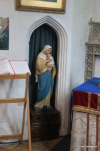 Henlow - St Mary. South aisle, statue and rood stair opening.
