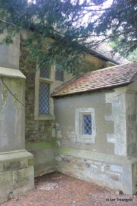 Hulcote - St Nicholas. Nave, south-west window and porch.