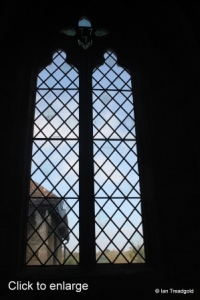 Renhold - All Saints. North aisle, Picot window, internal.