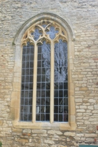 Riseley - All Saints. South aisle, west window.