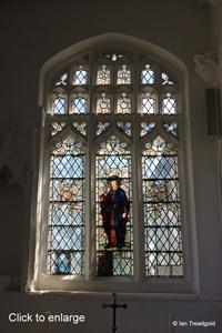 Arlesey, St Peter. North aisle, east window internal.