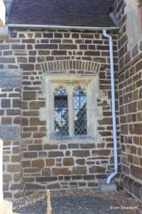 Stondon - All Saints. Nave, south-west window.