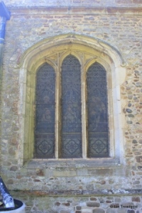 Sutton - All Saints. North aisle, north-west window.