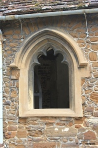 Blunham, St Edmund or St James. South porch west window.