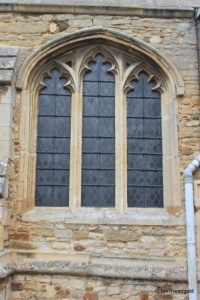 Cople - All Saints. South aisle, south-east window.