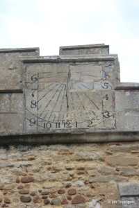 Cople - All Saints. Sundial on south aisle parapet.