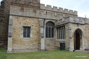 Cople - All Saints. South aisle and porch from the south-west.
