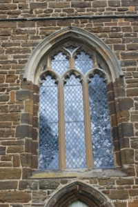 Cople - All Saints. West window.