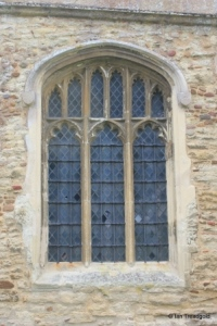 Cople - All Saints. East window of north chapel.