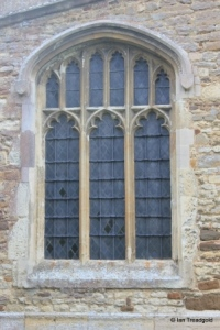 Cople - All Saints. South chapel, east window.