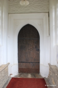 Cople - All Saints. South doorway.