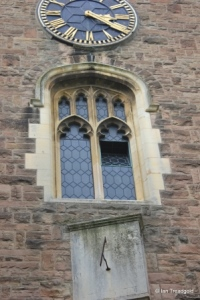 Cardington - St Mary. Tower, sundial, south window and clock.