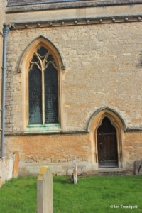 Turvey - All Saints. Chancel, south-west window and door.