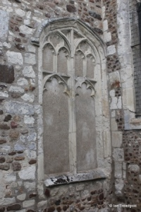 Cockayne Hatley - St John the Baptist. South aisle, blocked east window.