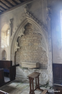 Yelden - St Mary. South aisle, tomb recess.