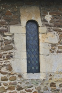 Everton - St Mary. Chancel, north round arch window.