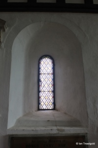 Everton - St Mary. Chancel, north round arch window internal.
